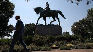 CHARLOTTESVILLE, VA - AUGUST 22: The statue of Confederate Gen. Robert E. Lee stands in the center of the renamed Emancipation Park on August 22, 2017 in Charlottesville, Virginia. A decision to remove the statue caused a violent protest by white nationalists, neo-Nazis, the Ku Klux Klan and members of the 'alt-right'.   Mark Wilson/Getty Images/AFP
