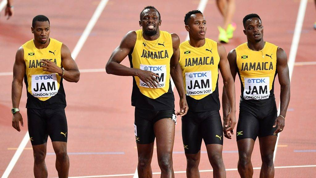 """LONDON, UNITED KINGDOM - AUGUST 12: Jamaica's Men's 4x100m Relay Team Julian Forte, Yohan Blake, Usain Bolt and Omar McLeod react after Bolt falls during the """"IAAF Athletics World Championships London 2017"""" at London Stadium in the Queen Elizabeth Olympic Park in London, United Kingdom on August 12, 2017. Mustafa Yalcin / Anadolu Agency"""