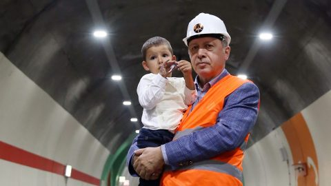 """RIZE, TURKEY - AUGUST 07 : (----EDITORIAL USE ONLY – MANDATORY CREDIT - """" TURKISH PRESIDENCY / MURAT CETINMUHURDAR / HANDOUT"""" - NO MARKETING NO ADVERTISING CAMPAIGNS - DISTRIBUTED AS A SERVICE TO CLIENTS----) Turkish President Recep Tayyip Erdogan poses for a photo with a boy at Ovit Tunnel as he analyzes the developments of Ovit Tunnel in Rize, Turkey on August 07, 2017. When the tunnel completed, it will be the World's second longest tunnel. The cost of the tunnel amounted to 1.1 billion Turkish liras ($351 million). The tunnel's lowest point is located at one extremity at 1,919 meters of altitude and its highest at the other end at an altitude of 2,236 meters. The tunnel will shorten the 250-kilometer-long Rize - Erzurum intercity highway to 200 and will allow residents of the eastern Turkish provinces to reach the Black Sea faster. Turkish Presidency / Murat Cetinmuhurdar / Handout / Anadolu Agency"""