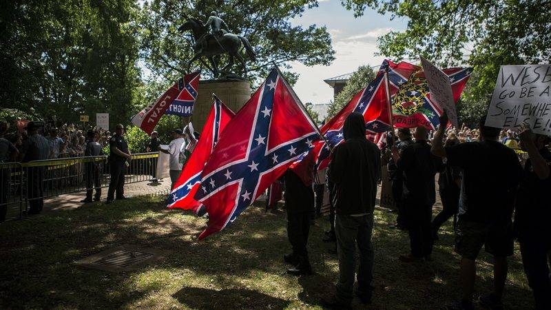 CHARLOTTESVILLE, VA - JULY 08: The Ku Klux Klan protests on July 8, 2017 in Charlottesville, Virginia. The KKK is protesting the planned removal of a statue of General Robert E. Lee, and calling for the protection of Southern Confederate monuments. (Photo by Chet Strange/Getty Images)