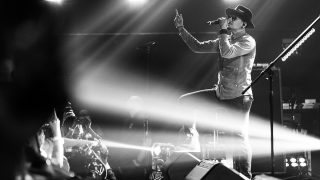 BURBANK, CA - MAY 22: (EDITORS NOTE: Image has been converted to black and white.) Chester Bennington of Linkin Park performs on stage at the iHeartRadio Album Release Party presented by State Farm at the iHeartRadio Theater Los Angeles on May 22, 2017 in Burbank, California.   Rich Fury/Getty Images for iHeartMedia/AFP
