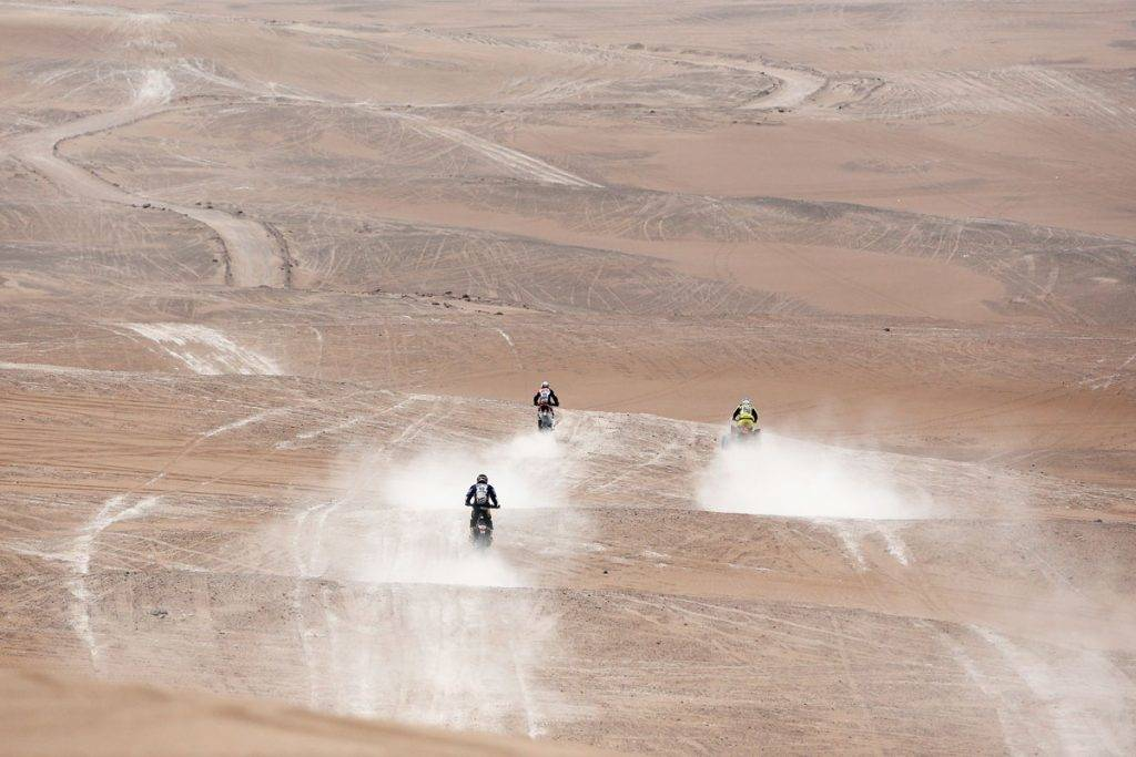 IQUIQUE, CHILE - JANUARY 13:  #45 Bruno Da Costa of France for HFP Yamaha YZF450, #49 Emanuel Gyenes of Romania for Autonet Motorcycle team and #250 Ignacio Casale of Chile for Tamarugal XC Rally team Raptor 700 Yamaha compete in the Atacama Desert during day 10 of the Dakar Rallly between Iquique on Calama January 13, 2015 in Iquique, Chile.  (Photo by Dean Mouhtaropoulos/Getty Images)
