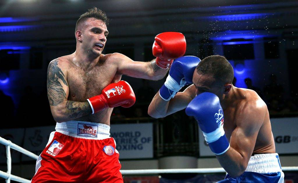 LONDON, ENGLAND - APRIL 06:  Zoltan Harcsa of British Lionhearts (Red Gloves) fights Nizar Trimech of France Fighting Roosters (Blue Gloves) during the World Series of Boxing at York Hall on April 6, 2017 in London, England.  (Photo by Alex Pantling/Getty Images)