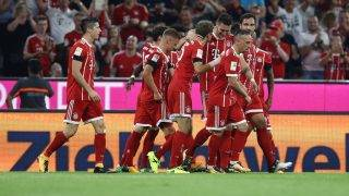 MUNICH, GERMANY - AUGUST 18: Niklas Suele of Bayern Munich celebrates his goal with his team mates during the Bundesliga match between FC Bayern Muenchen and Bayer 04 Leverkusen at Allianz Arena on August 18, 2017 in Munich, Germany. (Photo by Maja Hitij/Bongarts/Getty Images)