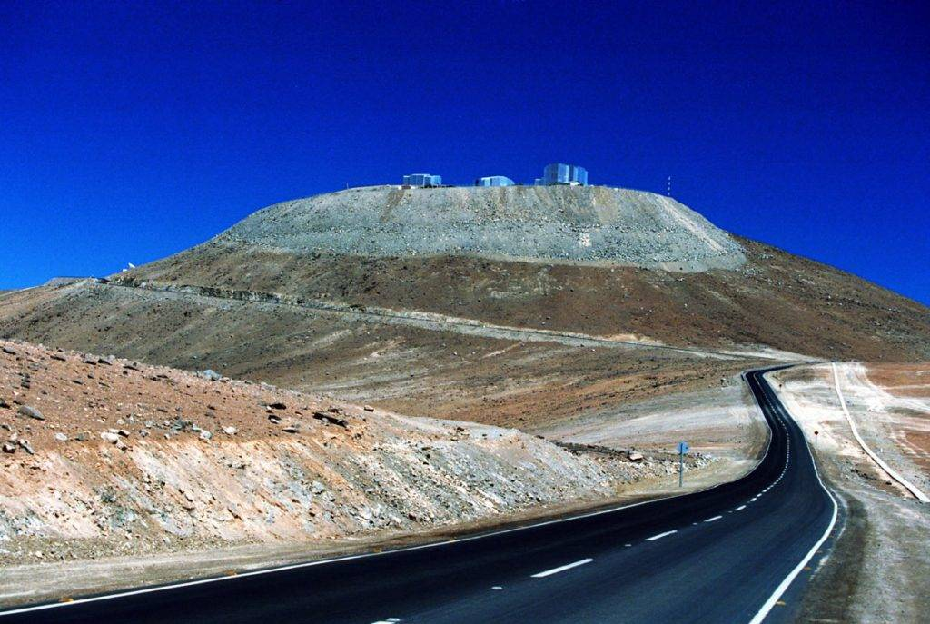 PARANAL, CHILE - OCTOBER 26:  A street leads to the Very Large Telescope (VLT) in the Atacama desert on October 26, 2000, in Paranal, Chile. The VLT Observatory comprises, among others, four 8,2 meter optical telescopes organized in an array formation. The four optical telescopes, the Antu telescope, the Kueyen telescope, the Melipal telescope, and the Yepun telescope work together and their data is being combined by interferometry to finally obtain a resolution high enough to see a man on the moon. The World's largest  optical telescope is being operated by the European Southern Observatory ESO, it is located at the Cerro Paranal, believed to be the driest area on Earth, on a 2,635 m high mountain in Northern Chile, about 120 km south of the town of Antofagasta and 12 km inland from the Pacific Coast.  (Photo by Sven Creutzmann/Getty Images)
