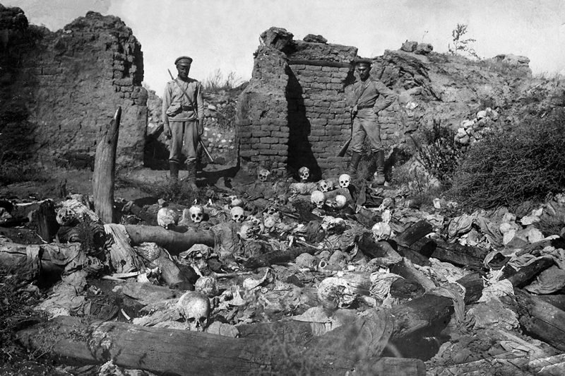 A picture released by the Armenian Genocide Museum-Institute dated 1915 purportedly shows soldiers standing over skulls of victims from the Armenian village of Sheyxalan in the Mush valley, on the Caucasus front during the First World War. Armenians say up to 1.5 million of their forebears were killed in a 1915-16 genocide by Turkey's former Ottoman Empire. Turkey says 500,000 died and ascribes the toll to fighting and starvation during World War I. AFP PHOTO / ARMENIAN GENOCIDE MUSEUM INSTITUTE / AFP PHOTO / AGMI / STR