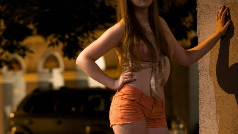 Prostitute waiting for somebody at night, horizontal