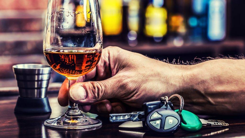 Alcoholism. Cup cognac whiskey or brandy hand man the keys to the car and irresponsible driver.