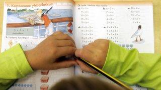 A child of the second grade studies his school book in a primary school in Vaasa, 17 august 2005, on their second day of school in Finland. According to a recent European study, Finland has the best academic results in Europe thanks to its educational system. / AFP PHOTO / OLIVIER MORIN