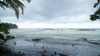 """A picture shows the ocean on September 18, 2017, in Basse-Terre, on the Fench Caribbean island of Guadeloupe, as Hurricane Maria approaches the Caribbean. Hurricane Maria strengthened rapidly on September 18 as it blasted towards the eastern Caribbean, forcing exhausted islanders -- still recovering from megastorm Irma -- to brace for the worst again. The US National Hurricane Center (NHC) said the """"major hurricane"""" had intensified to Category 3 as it approached the French island of Guadeloupe, the base for relief operations for several islands devastated by Irma this month. / AFP PHOTO / Cedrick Isham CALVADOS"""