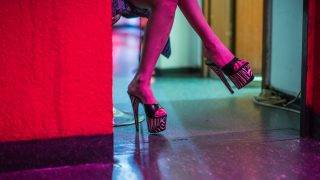 A prostitute waits for customers in her room ata brothel in Frankfurt am Main, Germany, 12 July 2017. Photo: Andreas Arnold/dpa