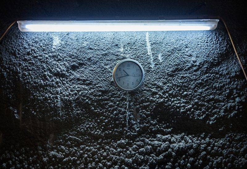 A clock is fixed to a wall in the nuclear waste repository shaft Konrad at a depth of 1000 metres in Salzgitter, Germany, 15 August 2017. The former iron ore mine is currently being prepared for the future use as a nuclear waste repository at various points. Photo: Silas Stein/dpa