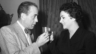 Italian actress Gina Lollobrigida (Luigina Lollobrigida) and American actor Humphrey Bogart (Humphrey DeForest Bogart) drinking a toast after shooting the film Beat the Devil. Rome, 1953