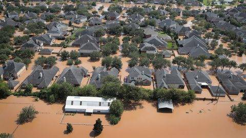 SUGAR LAND, TX - AUGUST 31: Homes are surrounded by floodwater after torrential rains pounded Southeast Texas following Hurricane and Tropical Storm Harvey on August 31, 2017 in Sugar Land, Texas. Harvey, which made landfall north of Corpus Christi August 25, has dumped nearly 50 inches of rain in and around areas Houston.   Scott Olson/Getty Images/AFP