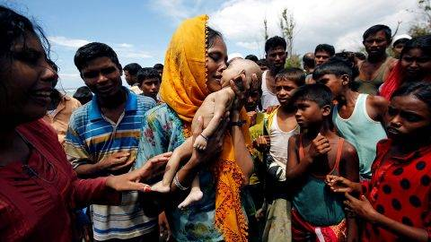 """ATTENTION EDITORS - VISUAL COVERAGE OF SCENES OF INJURY OR DEATH Hamida, a Rohingya refugee woman, cries as she holds her 40-day-old son, who died as a boat capsized in the shore of Shah Porir Dwip, in Teknaf, Bangladesh, September 14, 2017. REUTERS/Mohammad Ponir Hossain/File photo         SEARCH """"ROHINGYA CAPSIZED"""" FOR THIS STORY. SEARCH """"WIDER IMAGE"""" FOR ALL STORIES.  TEMPLATE OUT   TPX IMAGES OF THE DAY"""