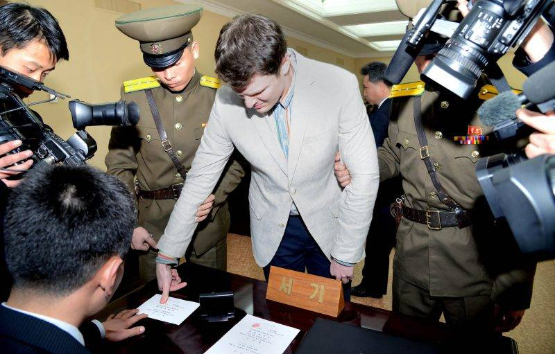 "This picture taken and released from North Korea's official Korean Central News Agency (KCNA) on March 16, 2016 shows the trial of US student Otto Frederick Warmbier, who was arrested for committing hostile acts against North Korea, at the Supreme Court in Pyongyang. North Korea on March 16 sentenced an American student who admitted stealing a propaganda banner from a hotel to 15 years' hard labour for subversive activities, state media said. / AFP PHOTO / KCNA / KCNA /  - South Korea OUT / REPUBLIC OF KOREA OUT   ---EDITORS NOTE--- RESTRICTED TO EDITORIAL USE - MANDATORY CREDIT ""AFP PHOTO/KCNA VIA KNS"" - NO MARKETING NO ADVERTISING CAMPAIGNS - DISTRIBUTED AS A SERVICE TO CLIENTS THIS PICTURE WAS MADE AVAILABLE BY A THIRD PARTY. AFP CAN NOT INDEPENDENTLY VERIFY THE AUTHENTICITY, LOCATION, DATE AND CONTENT OF THIS IMAGE. THIS PHOTO IS DISTRIBUTED EXACTLY AS RECEIVED BY AFP.  /"
