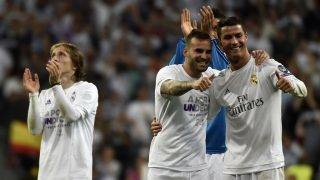 Real Madrid's Croatian midfielder Luka Modric (L), Real Madrid's forward Jese Rodriguez (C) and Real Madrid's Portuguese forward Cristiano Ronaldo celebrate their victory at the end of the UEFA Champions League semi-final second leg football match Real Madrid CF vs Manchester City FC at the Santiago Bernabeu stadium in Madrid, on May 4, 2016. / AFP PHOTO / GERARD JULIEN