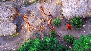 Picture released on May 29, 2008 by the Brazilian Indian Protection Foundation (FUNAI) showing members of an indigenous tribe, discovered in 1910, with their bodies painted in bright red staring at the aircraft from which the pictures were taken, in the Amazon region in the Brazilian-Peruvian border. The FUNAI released the pictures to show the existence of isolated tribes in the Amazon region, and warn about the threat of invasion or extinction. British environmental NGO Survival International, which first released the pictures, suggested in a statement that the tribe was unknown, which revealed to be false..  AFP PHOTO/GEISON MIRANDA - FUNAI / AFP PHOTO / FUNAI / GEISON MIRANDA