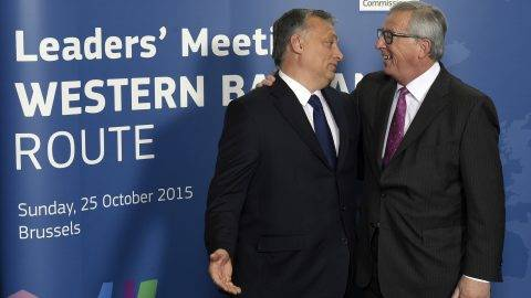 EU Commission President Jean Claude Juncker (R) welcomes Hungary Prime minister Viktor Orban prior to an European leader's meeting on refugee flows along the Western Balkans route at the European Commission in Brussels on October 25, 2015. European Union and Balkan leaders faced a make-or-break summit today on the deepening refugee crisis after three frontline states threatened to close their borders if their EU peers stopped accepting migrants.   AFP PHOTO / JOHN THYS / AFP PHOTO / JOHN THYS