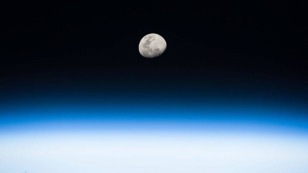 """This NASA handout image of the Moon, released on August 8, 2017 was taken from his vantage point in low Earth orbit aboard the International Space Station, by NASA astronaut Randy Bresnik as he pointed his camera and captured this image on August 3, 2017.  Looking forward to the August 21 total solar eclipse, Bresnik wrote, """"Gorgeous moon rise! Such great detail when seen from space. Next full moon marks #Eclipse2017. We'll be watching from @Space_Station."""" / AFP PHOTO / NASA / Handout / RESTRICTED TO EDITORIAL USE - MANDATORY CREDIT """"AFP PHOTO / NASA/RANDY BRESNIK"""" - NO MARKETING NO ADVERTISING CAMPAIGNS - DISTRIBUTED AS A SERVICE TO CLIENTS"""
