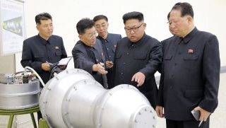 """This undated picture released by North Korea's official Korean Central News Agency (KCNA) on September 3, 2017 shows North Korean leader Kim Jong-Un (C) looking at a metal casing with two bulges at an undisclosed location. North Korea has developed a hydrogen bomb which can be loaded into the country's new intercontinental ballistic missile, the official Korean Central News Agency claimed on September 3. Questions remain over whether nuclear-armed Pyongyang has successfully miniaturised its weapons, and whether it has a working H-bomb, but KCNA said that leader Kim Jong-Un had inspected such a device at the Nuclear Weapons Institute. / AFP PHOTO / KCNA VIA KNS / STR / South Korea OUT / REPUBLIC OF KOREA OUT   ---EDITORS NOTE--- RESTRICTED TO EDITORIAL USE - MANDATORY CREDIT """"AFP PHOTO/KCNA VIA KNS"""" - NO MARKETING NO ADVERTISING CAMPAIGNS - DISTRIBUTED AS A SERVICE TO CLIENTS THIS PICTURE WAS MADE AVAILABLE BY A THIRD PARTY. AFP CAN NOT INDEPENDENTLY VERIFY THE AUTHENTICITY, LOCATION, DATE AND CONTENT OF THIS IMAGE. THIS PHOTO IS DISTRIBUTED EXACTLY AS RECEIVED BY AFP.  /"""