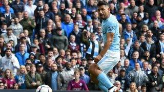 Manchester City's Argentinian striker Sergio Aguero shoots to score the opening goal of the English Premier League football match between Manchester City and Liverpool at the Etihad Stadium in Manchester, north west England, on September 9, 2017. / AFP PHOTO / PAUL ELLIS / RESTRICTED TO EDITORIAL USE. No use with unauthorized audio, video, data, fixture lists, club/league logos or 'live' services. Online in-match use limited to 75 images, no video emulation. No use in betting, games or single club/league/player publications.  /