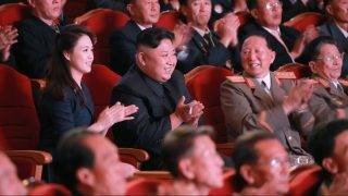 """This undated picture released by North Korea's official Korean Central News Agency (KCNA) on September 10, 2017 shows North Korean leader Kim Jong-Un (centre row 2nd L) and his wife Ri Sol-Ju (centre row L) attending an art performance dedicated to nuclear scientists and technicians, who worked on a hydrogen bomb which the regime claimed to have successfully tested, at the People's Theatre in Pyongyang. / AFP PHOTO / KCNA VIA KNS / STR / South Korea OUT / REPUBLIC OF KOREA OUT   ---EDITORS NOTE--- RESTRICTED TO EDITORIAL USE - MANDATORY CREDIT """"AFP PHOTO/KCNA VIA KNS"""" - NO MARKETING NO ADVERTISING CAMPAIGNS - DISTRIBUTED AS A SERVICE TO CLIENTS THIS PICTURE WAS MADE AVAILABLE BY A THIRD PARTY. AFP CAN NOT INDEPENDENTLY VERIFY THE AUTHENTICITY, LOCATION, DATE AND CONTENT OF THIS IMAGE. THIS PHOTO IS DISTRIBUTED EXACTLY AS RECEIVED BY AFP.  /"""