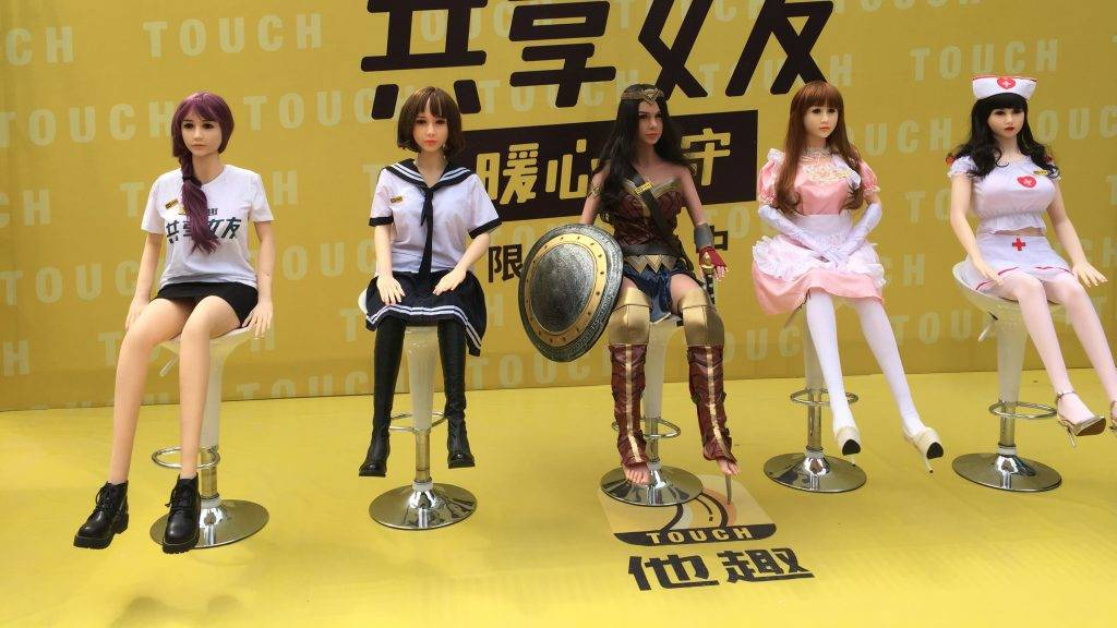 """EDITORS NOTE: Graphic content / This handout picture taken on September 14, 2017 released by Touch shows rentable sex dollS on display on a promotional event in Beijing.  China already has shared bikes, umbrellas, and basketballs, but one company is taking the country's embrace of the """"sharing economy"""" to a new extreme with a line of rentable sex dolls. The Chinese character on the T-shirtS read """"sharing girlfriend"""". / AFP PHOTO / Touch / HO / RESTRICTED TO EDITORIAL USE - MANDATORY CREDIT """"AFP PHOTO / Touch""""- NO MARKETING NO ADVERTISING CAMPAIGNS - DISTRIBUTED AS A SERVICE TO CLIENTS - NO ARCHIVES"""