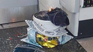"""A handout picture obtained from the twitter user @sylvainpennec shows a white container burning inside a London Underground tube carriage at Parsons Green underground tube station on September 15, 2017. More than 20 passengers were injured, some suffering severe burns, in an early morning explosion on a London Underground train in what police described as a """"terrorist incident,""""  the fifth attack in six months in Britain. Emergency services were called around 8:20 am (0720 GMT) after the explosion at Parsons Green station in a leafy southwestern suburb which police counter-terror chief Mark Rowley said had been caused by an """"improvised explosive device."""" / AFP PHOTO / @sylvainpennec / HO / ===RESTRICTED TO EDITORIAL USE - MANDATORY CREDIT """"AFP PHOTO / HO / @sylvainpennec - NO MARKETING NO ADVERTISING CAMPAIGNS -  NO ARCHIVES - DISTRIBUTED AS A SERVICE TO CLIENTS"""