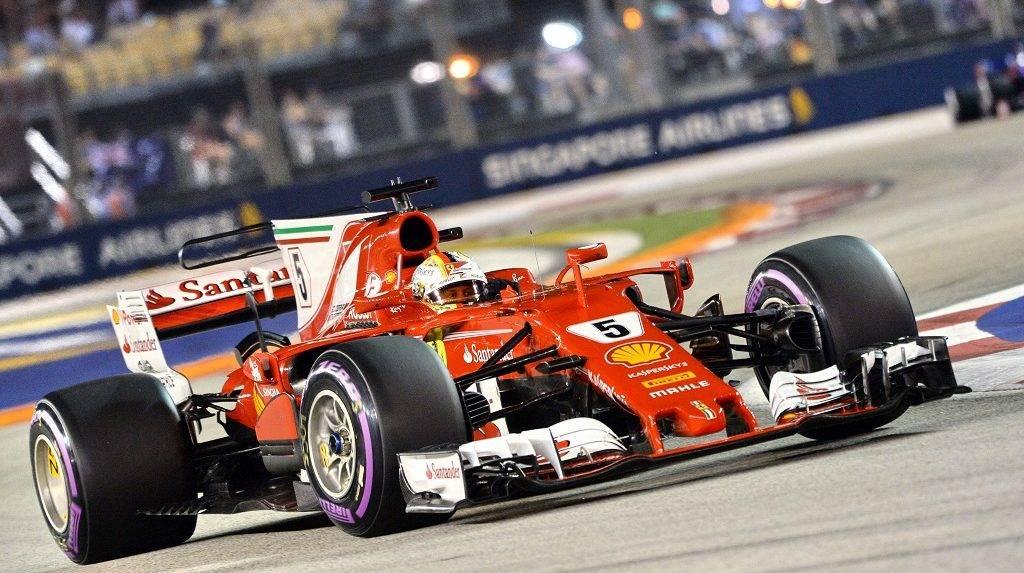 Ferrari's German driver Sebastian Vettel drives during the qualifying session of the Formula One Singapore Grand Prix in Singapore on September 16, 2017.  / AFP PHOTO / Roslan RAHMAN