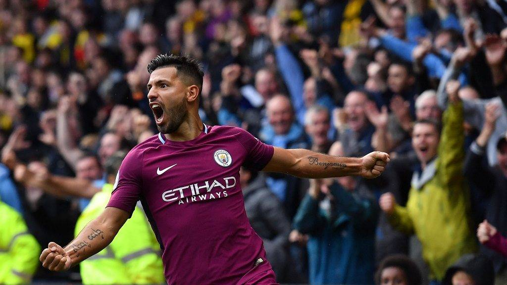 Manchester City's Argentinian striker Sergio Aguero celebrates scoring  his third and the team's fifth goal during the English Premier League football match between Watford and Manchester City at Vicarage Road Stadium in Watford, north of London on September 16, 2017. / AFP PHOTO / Ben STANSALL / RESTRICTED TO EDITORIAL USE. No use with unauthorized audio, video, data, fixture lists, club/league logos or 'live' services. Online in-match use limited to 75 images, no video emulation. No use in betting, games or single club/league/player publications.  /