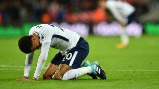 Tottenham Hotspur's English midfielder Dele Alli sinks to his knees at the final whistle in the English Premier League football match between Tottenham Hotspur and Swansea City at Wembley Stadium in London, on September 16, 2017. / AFP PHOTO / Glyn KIRK / RESTRICTED TO EDITORIAL USE. No use with unauthorized audio, video, data, fixture lists, club/league logos or 'live' services. Online in-match use limited to 75 images, no video emulation. No use in betting, games or single club/league/player publications.  /