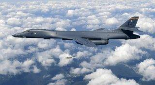 "This handout photo taken on September 18, 2017 and provided by the South Korean Defence Ministry in Seoul shows a US Air Force B-1B Lancer dropping a bomb at a shooting range in Gangwon Province, east of Seoul, during a joint military drill aimed to counter North Korea's latest nuclear and missile tests. The US flew four stealth fighter jets and two bombers over the Korean peninsula on September 18 in a show of force after North Korea's latest nuclear and missile tests, South Korea's defence ministry said. / AFP PHOTO / South Korean Defence Ministry / handout / RESTRICTED TO EDITORIAL USE - MANDATORY CREDIT ""AFP PHOTO / South Korean Defence Ministry"" - NO MARKETING NO ADVERTISING CAMPAIGNS - DISTRIBUTED AS A SERVICE TO CLIENTS"