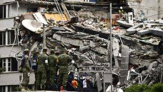 Rescuers search for survivors amid the rubble from a building flattened by the 7.1-magnitude quake the day before, in Mexico City, on September 20, 2019.   Rescuers frantically searched Wednesday for survivors of a powerful earthquake that killed more than 200 people in Mexico on the anniversary of another massive quake that left thousands dead and still haunts the country. / AFP PHOTO / RONALDO SCHEMIDT