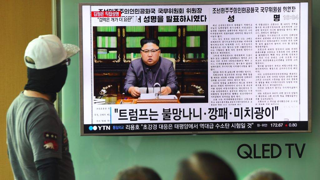 """People watch a television news screen showing a picture of North Korean leader Kim Jong-Un delivering a statement in Pyongyang, at a railway station in Seoul on September 22, 2017.  US President Donald Trump is """"mentally deranged"""" and will """"pay dearly"""" for his threat to destroy North Korea, Kim Jong-Un said on September 22, as his foreign minister hinted the regime may explode a hydrogen bomb over the Pacific Ocean. / AFP PHOTO / JUNG Yeon-Je"""