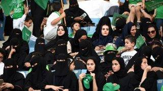 Saudi women sit in a stadium for the first time to attend an event in the capital Riyadh on September 23, 2017 commemorating the anniversary of the founding of the kingdom. The presence of women at the King Fahd stadium marks a departure from previous celebrations in the Gulf kingdom where they are effectively barred from sports arenas by strict rules on public segregation of the sexes. / AFP PHOTO / Fayez Nureldine