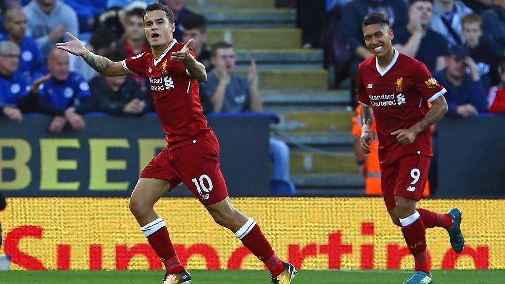 Liverpool's Brazilian midfielder Philippe Coutinho (L) celebrates after scoring their second goal from a freekick during the English Premier League football match between Leicester City and Liverpool at King Power Stadium in Leicester, central England on September 23, 2017. / AFP PHOTO / Geoff CADDICK / RESTRICTED TO EDITORIAL USE. No use with unauthorized audio, video, data, fixture lists, club/league logos or 'live' services. Online in-match use limited to 75 images, no video emulation. No use in betting, games or single club/league/player publications.  /