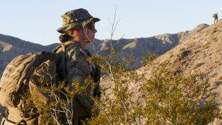 """This US Marine Corps photo obtained September 25, 2017 shows an unidentified Marine as she participates in an exercise during the Infantry Officer Course at Marine Corps Air Ground Combat Center Twentynine Palms, California, on September 18, 2017. A female Marine became the first woman on September 25, 2017 to complete the notoriously rigorous training course for US infantry officers. Many women serve as officers in the Marines and other branches of America's armed forces but the woman, who has not been identified publicly at her own request, is the first to finish the 13-week infantry officer training course.""""I am proud of this officer and those in her class,"""" Marine Corps commandant General Robert Neller said in a statement.   / AFP PHOTO / US MARINE CORPS / Gregory BOYD / RESTRICTED TO EDITORIAL USE - MANDATORY CREDIT """"AFP PHOTO / US MARINE CORPS/GREGORY BOYD/HANDOUT"""" - NO MARKETING NO ADVERTISING CAMPAIGNS - DISTRIBUTED AS A SERVICE TO CLIENTS"""