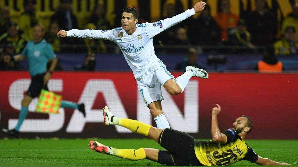 Real Madrid's forward from Portugal Cristiano Ronaldo (C) scores during the UEFA Champions League Group H football match BVB Borussia Dortmund v Real Madrid in Dortmund, western Germany on September 26, 2017. / AFP PHOTO / Patrik STOLLARZ