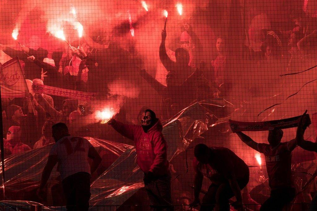 Fans of Red Star Belgrade light flares during the UEFA Europa League group H football match between FC Cologne and FC Red Star Belgrade in Cologne, western Germany, on September 28, 2017.   / AFP PHOTO / dpa / Federico Gambarini / Germany OUT