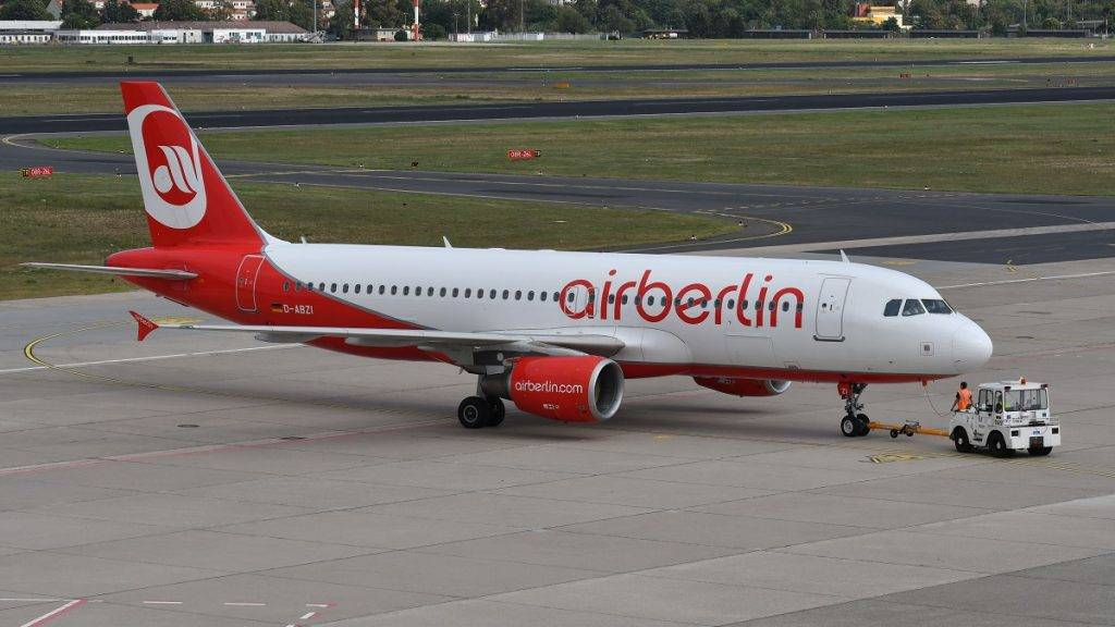 An airplane of Air Berlin can be seen at Tegel Airport in Berlin, Germany, 12 September 2017. Due to sick notes of numerous pilots Air Berlin cancelled dozens of flights on Tuesday. Photo: Paul Zinken/dpa