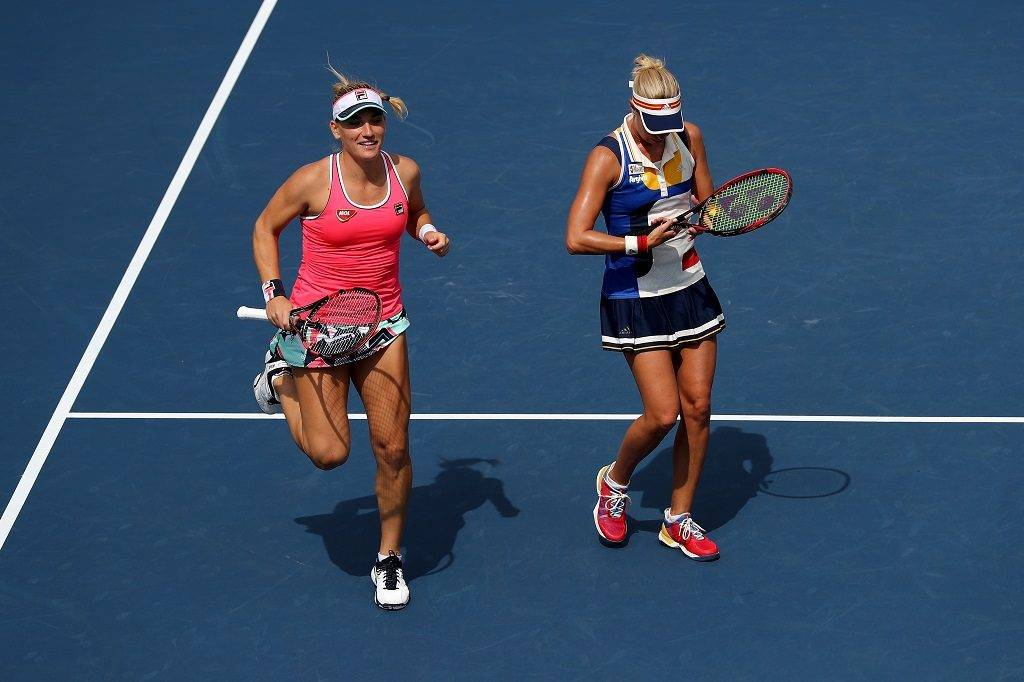 NEW YORK, NY - SEPTEMBER 07: Timea Babos of Hungary and Andrea Hlavackova of the Czech Republic react against Sania Mirza of India and Shuai Peng of China during their Women's Doubles Fourth Round match on Day Eleven of the 2017 US Open at the USTA Billie Jean King National Tennis Center on September 7, 2017 in the Flushing neighborhood of the Queens borough of New York City.   Elsa/Getty Images/AFP