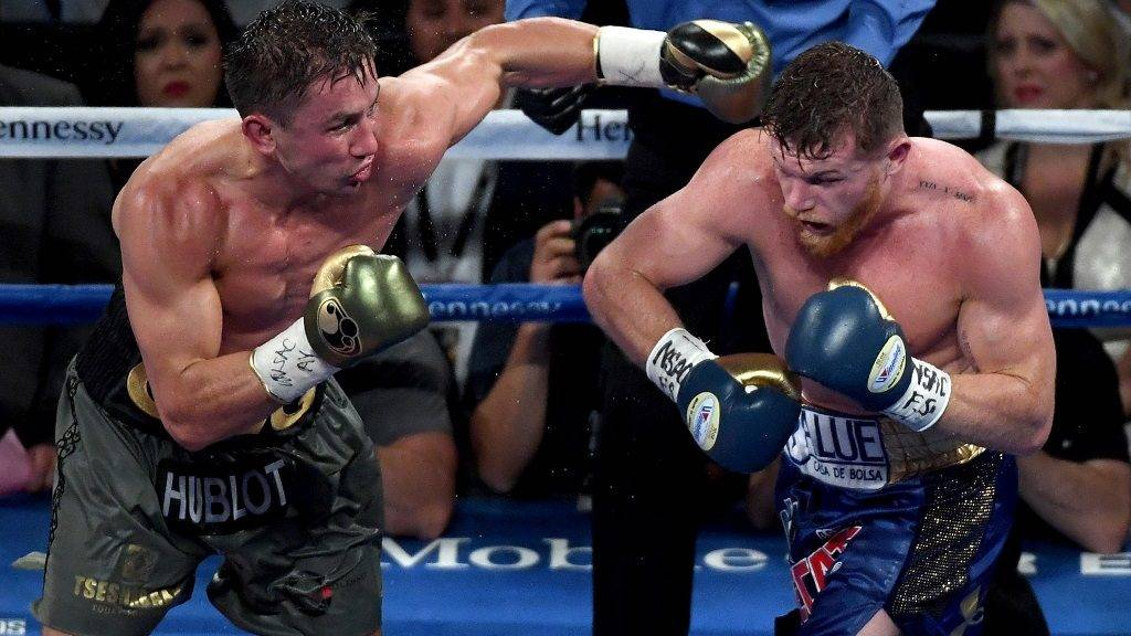 LAS VEGAS, NV - SEPTEMBER 16: (L-R) Gennady Golovkin throws a punch at Canelo Alvarez during their WBC, WBA and IBF middleweight championionship bout at T-Mobile Arena on September 16, 2017 in Las Vegas, Nevada.   Ethan Miller/Getty Images/AFP