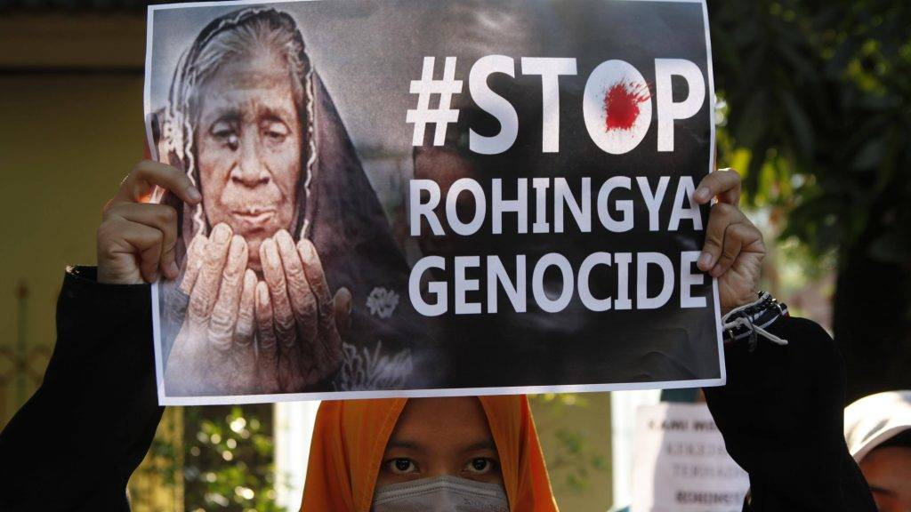 """JAKARTA, INDONESIA - SEPTEMBER 15: A protester holds a banner reading """"#Stop Rohingya Genocide"""" during a demonstration in support of Rohingya Muslims outside of Myanmar Embassy in Jakarta, Indonesia, on September 15, 2017. Indonesian Muslims condemned the Myanmar army's military operations and oppression towards Rohingya Muslims in Rakhine State of Myanmar.  Agoes Rudianto  / Anadolu Agency"""