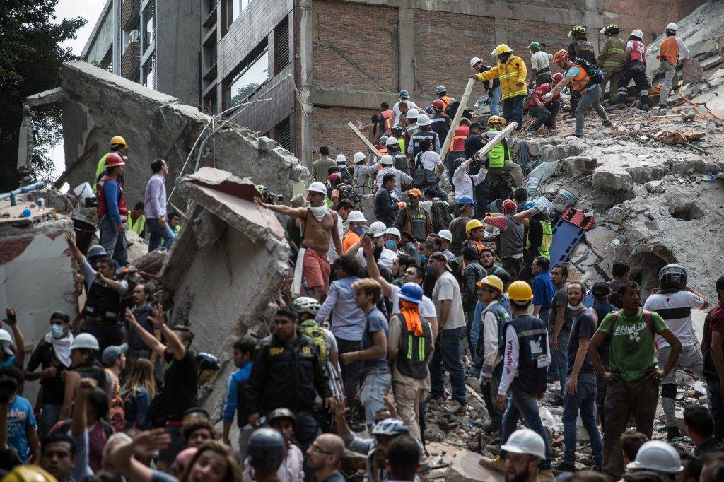 MEXICO CITY, MEXICO -  SEPTEMBER 19: Rescue workers perform their services over the collapsed buildings after powerful magnitude 7.1 earthquake hit Mexico City, killing dozens and causing widespread panic in Mexico on September 19, 2017.  Daniel Cardenas / Anadolu Agency