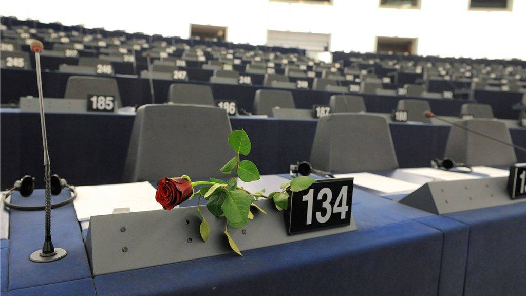 """A rose is displayed in front of the seat of a woman deputy to celebrate the 100th International Women's Day at the European Parliament in the French eastern city of Strasbourg, on March 8, 2011. The European Union used the International Women's Day to hail women's """"crucial role in bringing about change in northern Africa"""". AFP PHOTO / PATRICK HERTZOG / AFP PHOTO / PATRICK HERTZOG"""