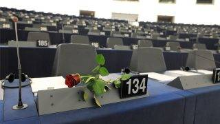 "A rose is displayed in front of the seat of a woman deputy to celebrate the 100th International Women's Day at the European Parliament in the French eastern city of Strasbourg, on March 8, 2011. The European Union used the International Women's Day to hail women's ""crucial role in bringing about change in northern Africa"". AFP PHOTO / PATRICK HERTZOG / AFP PHOTO / PATRICK HERTZOG"