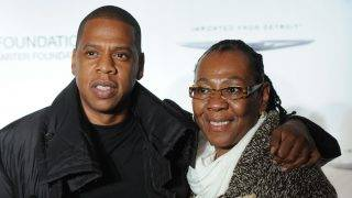"""NEW YORK, NY - SEPTEMBER 29:  Jay-Z poses with his mother, Gloria Carter during an evening of """"Making The Ordinary Extraordinary"""" hosted by The Shawn Carter Foundation at Pier 54 on September 29, 2011 in New York City.  (Photo by Jamie McCarthy/WireImage)"""