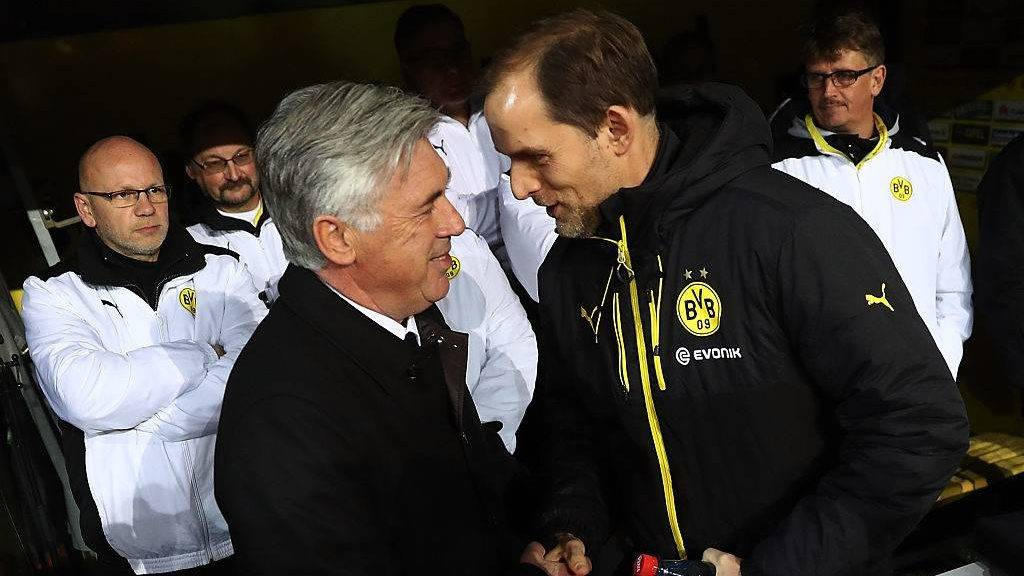 DORTMUND, GERMANY - NOVEMBER 19:  Thomas Tuchel Head Coach of Borussia Dortmund greets Carlo Ancelotti Head Coach of Bayern Munich during the Bundesliga match between Borussia Dortmund and Bayern Muenchen at Signal Iduna Park on November 19, 2016 in Dortmund, Germany.  (Photo by Alex Grimm/Bongarts/Getty Images)
