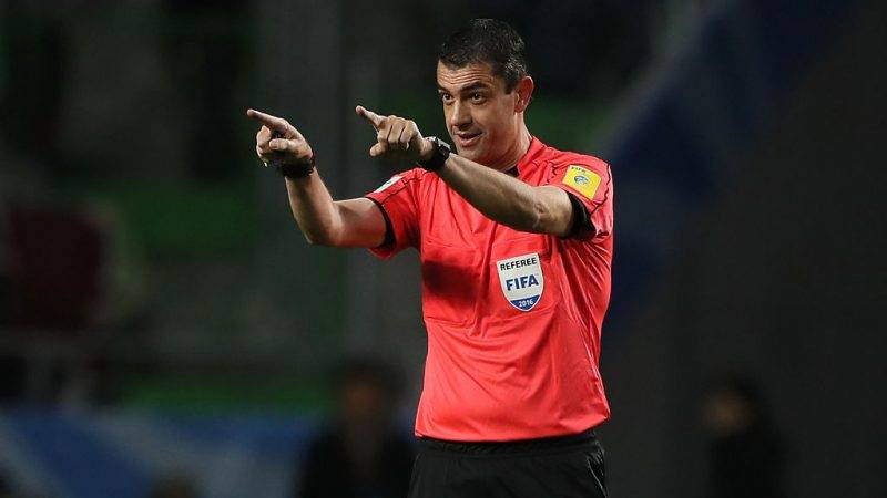SUITA, JAPAN - DECEMBER 14:  Referee Viktor Kassai gestures during the FIFA Club World Cup Semi Final match between Atletico Nacional and Kashima Antlers at Suita City Football Stadium on December 14, 2016 in Suita, Japan.  (Photo by Matthew Ashton - AMA/Getty Images)